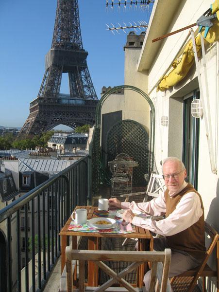paul enjoying breakfast on our apartment terrace - Paris Apartments